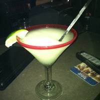 Photo taken at Rojo Mexican Grill by Jamie L. on 3/8/2012