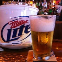 Photo taken at Miller's Miami Falls Ale House by Juan C. on 8/17/2012