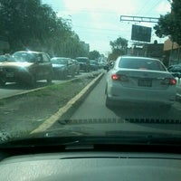 Photo taken at Av. División del Norte by Christelle M. on 7/11/2012