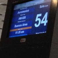 Photo taken at Sala/Gate 54 by Juan C A. on 7/17/2012