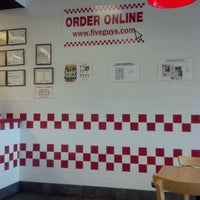 Photo taken at Five Guys by Fee B. on 7/13/2012