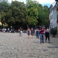 Photo taken at Augustinerplatz by Ian H. on 8/25/2012