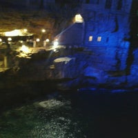 Photo taken at Grotta Palazzese by Andrea G. on 8/8/2012