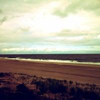 Photo taken at Long Branch Beach by Karina C. on 6/4/2012