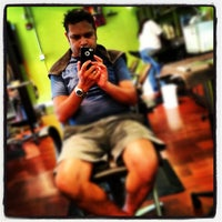 Photo taken at fresche salon & boutique by Hector A. on 6/19/2012