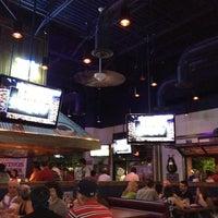 Photo taken at Wild Wing Cafe by Tim B. on 5/25/2012