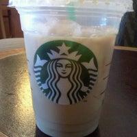 Photo taken at Starbucks by Elizabeth F. on 4/12/2012