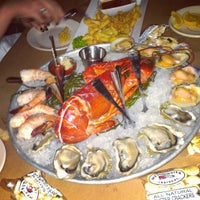 Photo taken at City Crab Shack by Moumin G. on 5/14/2012