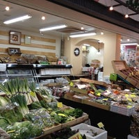 Photo taken at Omicho Market by hiroshi n. on 9/7/2012