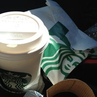 Photo taken at Starbucks by kim f. on 8/6/2012