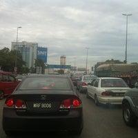 Photo taken at Persiaran Kewajipan Intersection by R Muhunthan R. on 7/11/2012