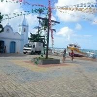 Photo taken at Praia do Forte by Saulo Q. on 7/2/2012