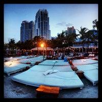 Photo taken at Nikki Beach Miami by Thiago F. on 7/4/2012