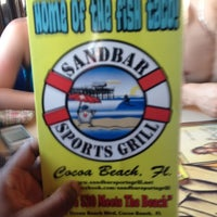 Photo taken at Sandbar Sports Grill by Marquise H. on 3/20/2012