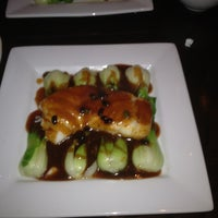 Photo taken at Kenny's Pan Asian Cuisine & Sushi Bar by Cathy C. on 3/2/2012