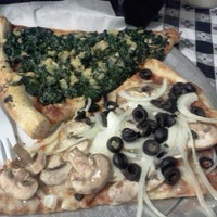 Photo taken at Rosa's Pizza by Ras E. on 3/27/2012