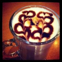 Photo taken at Urbe Café Bar by Rosana U. on 9/13/2012