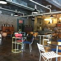 Photo taken at CAFÉ AMOKKA by Ji Ah Y. on 4/10/2012