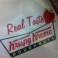 Photo taken at Krispy Kreme Doughnuts by J J. on 4/4/2012