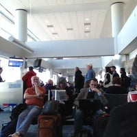 Photo taken at Gate B23 by Ryan S. on 2/26/2012