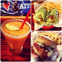 Photo taken at Red Robin Gourmet Burgers by Stephanie C. on 9/1/2012