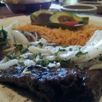 Photo taken at Cantina Laredo by Ariel V. on 7/14/2012