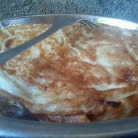 Photo taken at Uhuru Cafe by SAMUEL [DJ 254] B. on 5/21/2012