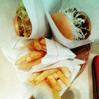Photo taken at MOS Burger by วัชรากร เ. on 4/1/2012
