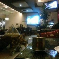 Photo taken at Windy Coffee & Bar by Dat N. on 5/9/2012