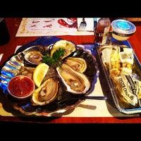 Photo taken at Seawitch Restaurant & Oyster Bar by Kristen B. on 7/18/2012