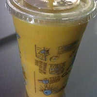 Photo taken at Caribou Coffee by Triniti J. on 4/4/2012