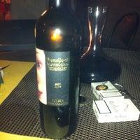 Photo taken at Enoteca il Mulino a Vino by Elda F. on 8/17/2012
