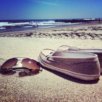 Photo taken at Asbury Park Beach by Cait O. on 6/2/2012