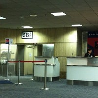 Photo taken at Gate 58A by Chikara 👹 K. on 8/19/2012