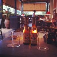 Photo taken at Grand Café de la Poste by Jean D. on 8/2/2012