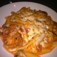 Photo taken at Bella's Italian Cafe by Geoffrey F. on 7/27/2012