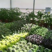 Photo taken at Farmer John's Greenhouse by Tanisha M. on 5/28/2012