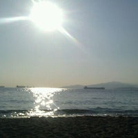 Photo taken at English Bay Beach by Ariel W. on 7/18/2012