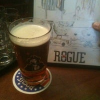 Photo taken at Rogue Ales Public House & Distillery by Keegan D. on 4/20/2012