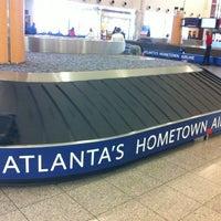 Photo taken at South Baggage Claim by Logan H. on 6/19/2012