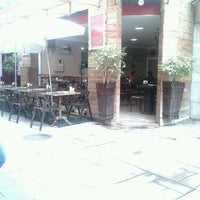 Photo taken at Espaço Café Central by Taísa S. on 7/6/2012