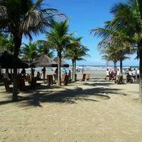 Photo taken at Praia do Sesc Bertioga by Maurício S. on 5/19/2012