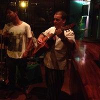 Photo taken at Café Milagro in Manuel Antonio by Travis D. on 3/10/2012