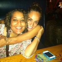 Photo taken at Voodoo Tiki Bar & Lounge by Celeste P. on 3/25/2012