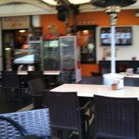Photo taken at Kontatto Cafe by Ciro S. on 2/11/2012