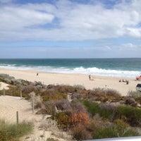 Photo taken at Scarborough Beach by Edmund T. on 3/30/2012