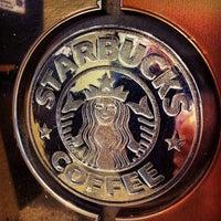 Photo taken at Starbucks by GoCatGo …. on 3/11/2012