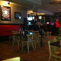 Photo taken at Upfront Bar & Grill by Moira F. on 2/23/2012