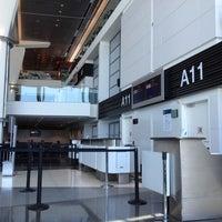 Photo taken at Gate A11 by Alex M. on 7/30/2012