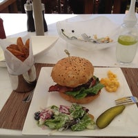 Photo taken at The Burger Custom Made by Adolfo L. on 3/20/2012